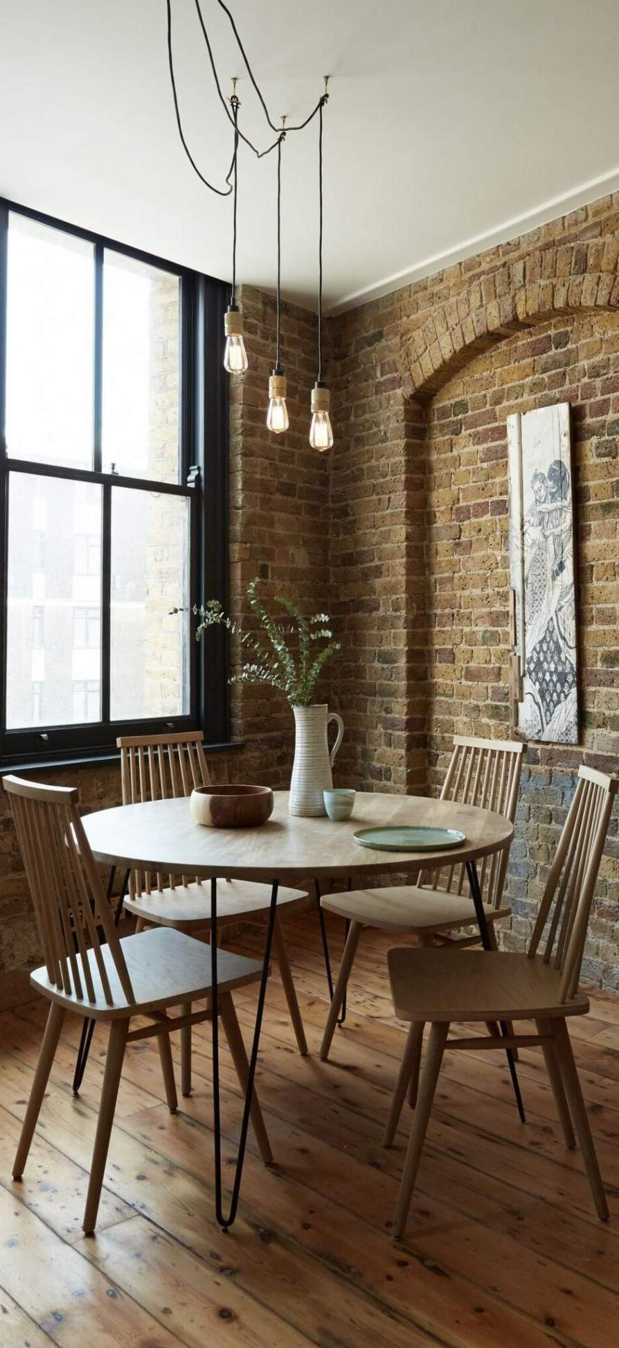 the niklas round dining table in mango wood and charcoal a simple industrial style wohnzimmer industrial style wohnzimmer